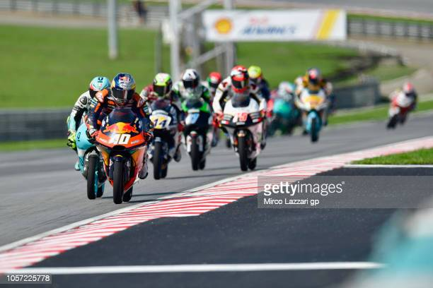 Darryn Binder of South Africa and Red Bull Team Ajo leads the field during the Moto3 race during the MotoGP Of Malaysia - Race at Sepang Circuit on...