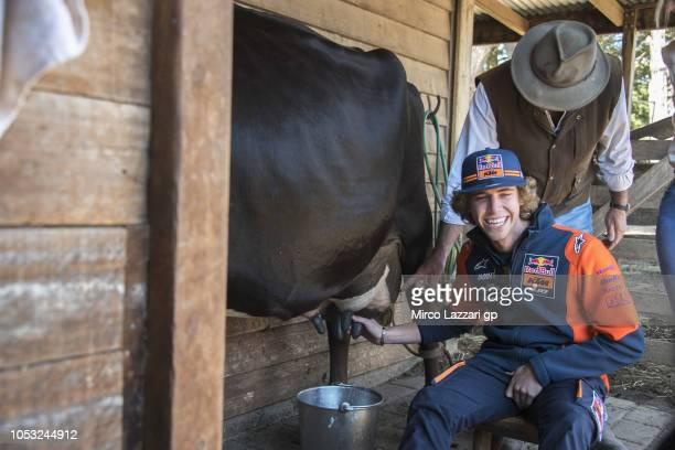 "Darryn Binder of South Africa and Red Bull Team Ajo smiles during the pre-event ""MotoGP Riders visiting the Churchill Farm"" during the MotoGP of..."