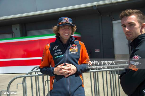 Darryn Binder of South Africa and Red Bull Team Ajo smiles with John McPhee of Great Britain and CIP Green Power in paddock during the MotoGP of...