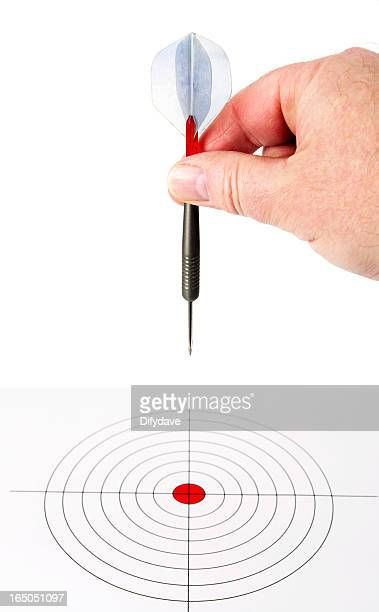 dart about to be dropped on target - darts stockfoto's en -beelden