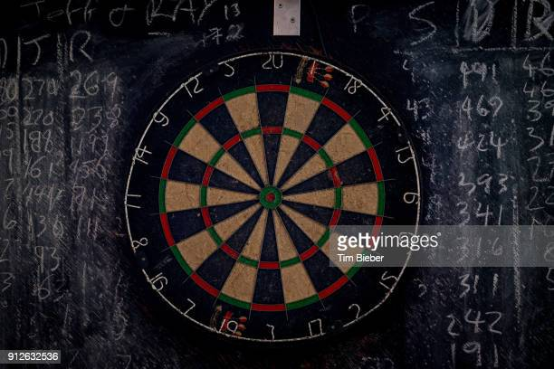 a dart board and chalk board - dart stock pictures, royalty-free photos & images