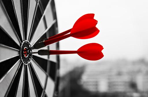 Dart board with three darts outdoors 1133497978