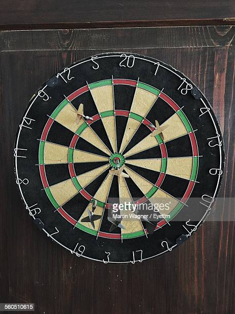 Dart In Bullseye Of Dart Board