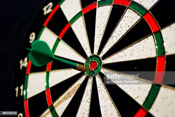 dart in target bull's-eye  - dartboard stock pictures, royalty-free photos & images