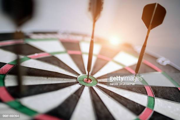 dart is an opportunity and dartboard is the target and goal. opportunity, risk management, business concept , success winner business concept - darts stock pictures, royalty-free photos & images