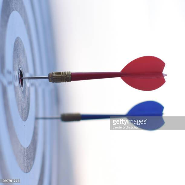 Dart is an opportunity and Dartboard is the target and goal. So both of that represent a challenge. opportunity, risk management, business concept , success winner business concept