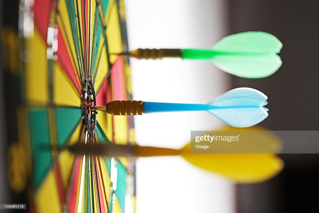 Dart on the bull's eye on the dartboard : Stock Photo