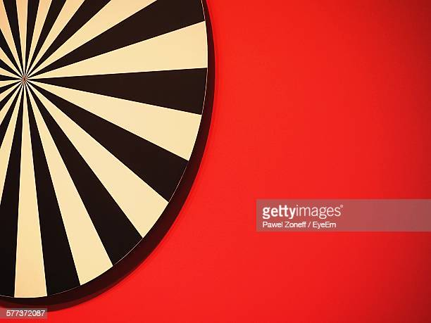 Dartboard Against Red Wall