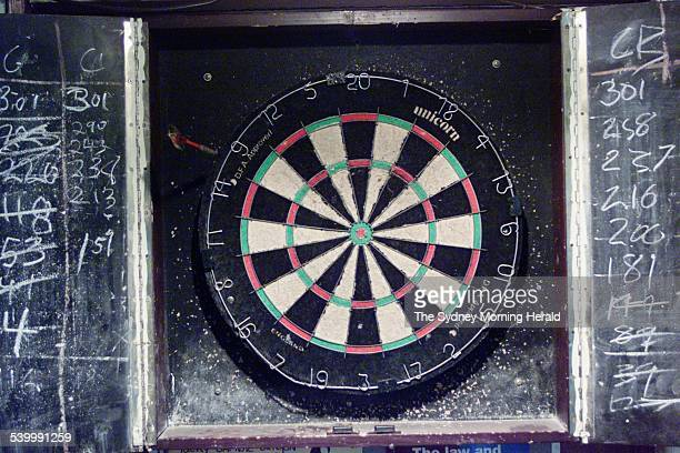 A dartboard and chalked scores 14 October 2002 SMH Picture by EDWINA PICKLES