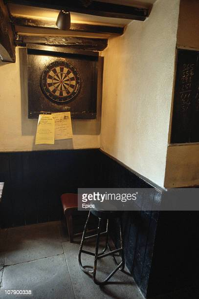 A dartboard provides the opportunity for some traditional pub sport in the Forresters Arms pub in the rural village of Carlton North Yorkshire April...