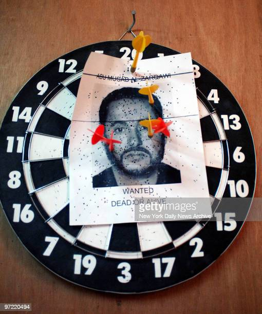 A dartboard with a wanted poster for Al Qaeda mastermind Abu Musab alZarqawi on it hangs on the wall above the desk of Major Chris Cerniauskas of the...