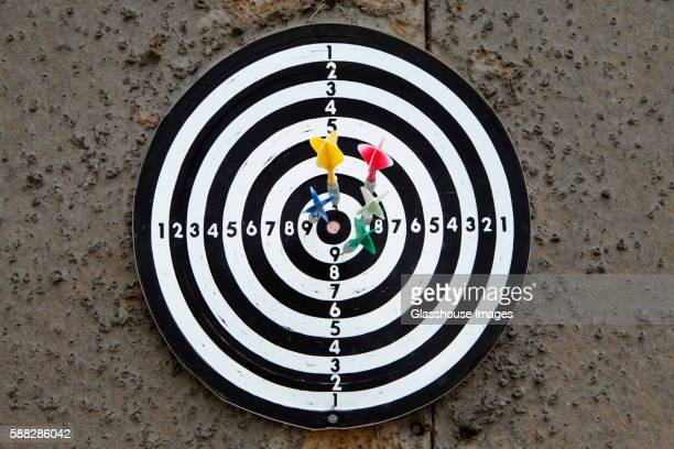 Dartboard With Darts Close to Bull's Eye