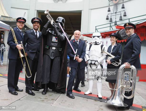 Darth Vader and a Storm Trooper pose beside the Salvation Army Band in front of the TCL Chinese Theater on May 24 2018 in Hollywood California The...