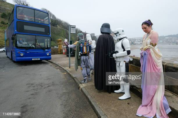 Darth Vader and other Star Wars characters wait for a bus on the second day of the Scarborough Sci-Fi weekend held at the seafront Spa Complex on...