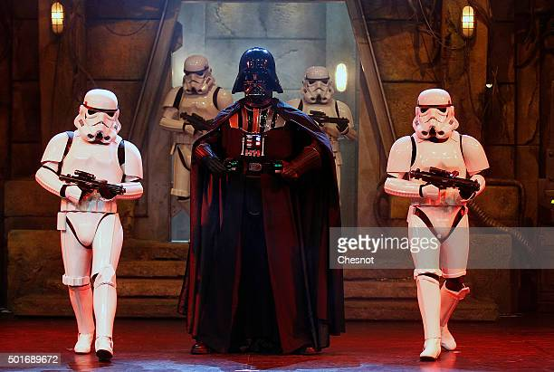 Darth Vader and Stormtrooper characters from 'Star Wars The Force Awakens' pose during 'Star Wars Episode VII The Force Awakens' party at Disneyland...