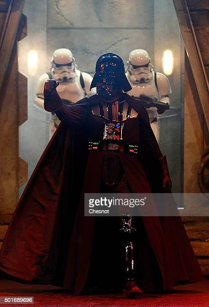 Darth Vader and Stormtrooper characters from Star Wars The Force Awakens pose during Star Wars Episode VII The Force Awakens party at Disneyland...