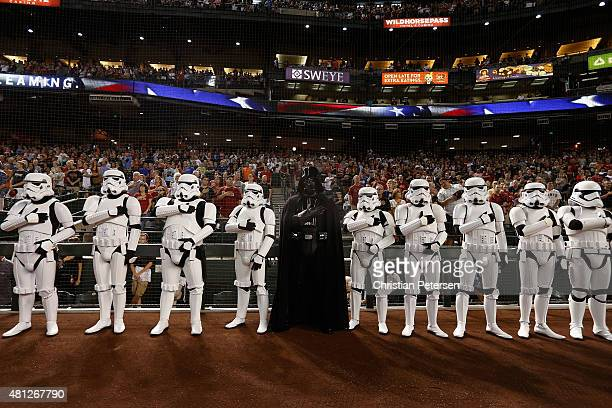 Darth Vader and Stormtroopers stand attended for the national anthem in honor of 'Star Wars' night before the MLB game between the Arizona...