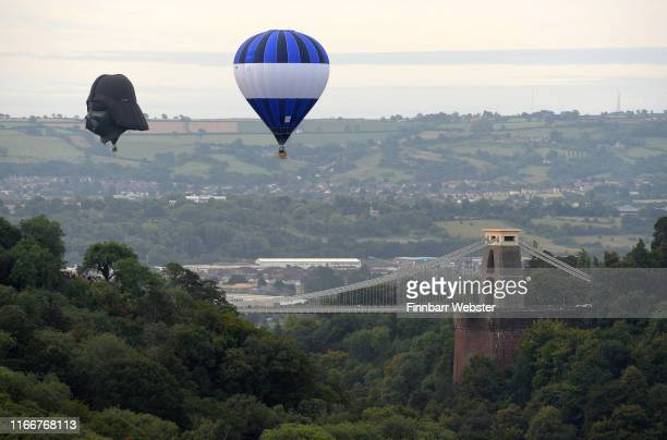 Darth Vader balloon above Clifton Suspension Bridge during the hot air balloons mass ascent at sunrise on the first day of the Bristol International...