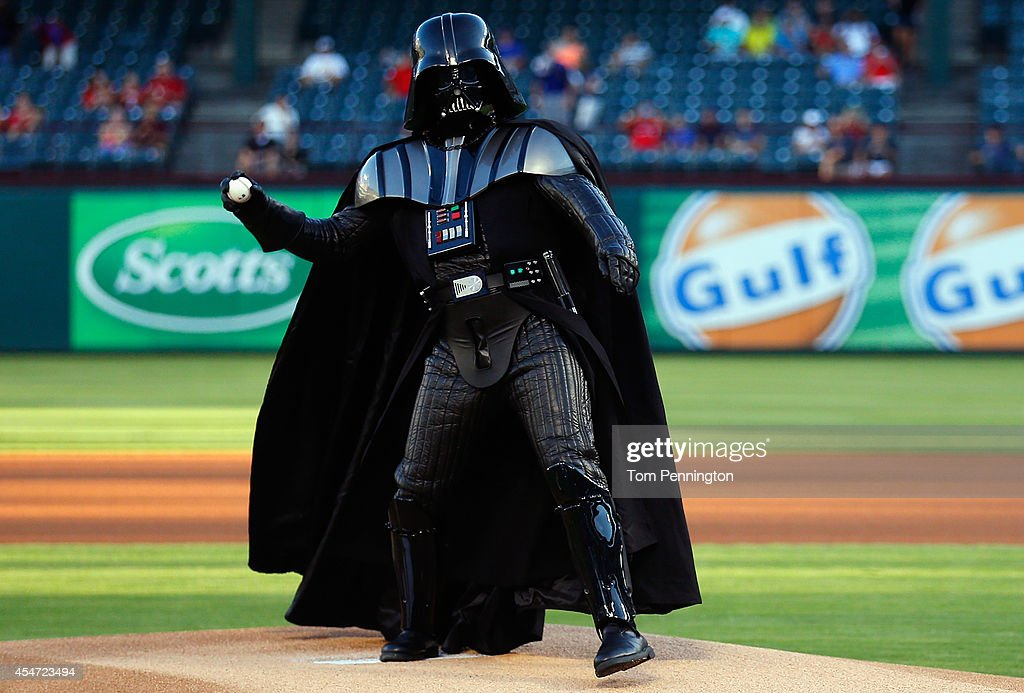 A Darth Vader character from 501st Legion throws out the ceremonial first pitch before the Seattle Mariners take on the Texas Rangers at Globe Life Park in Arlington on September 5, 2014 in Arlington, Texas.