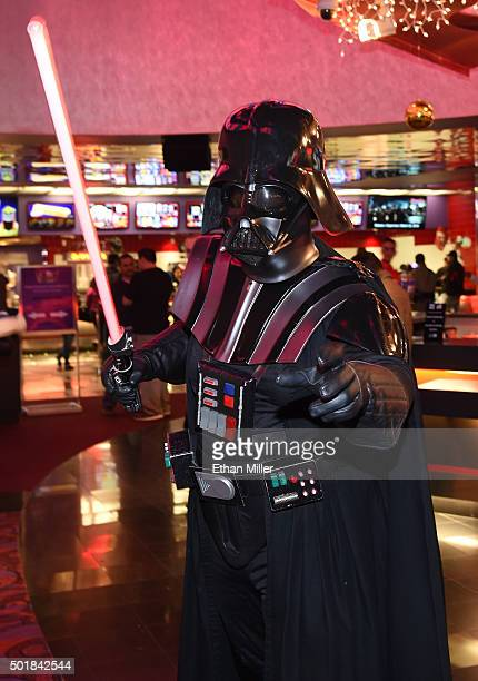 Darth Vader cosplayer from The Twin Suns Star Wars Club poses for fan photos on opening night of Walt Disney Pictures And Lucasfilm's Star Wars The...