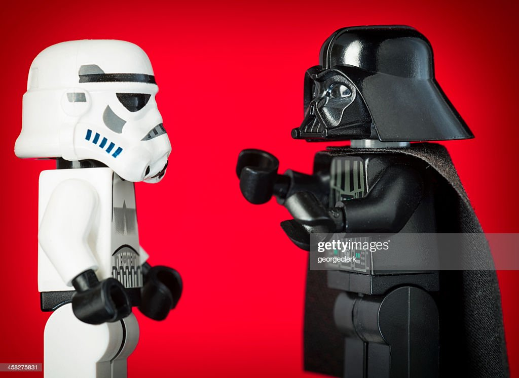 Darth Vader Lego Figurine Commanding a Stormtrooper : Stock Photo