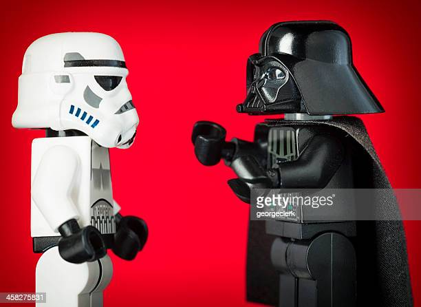 darth vader lego figurine commanding a stormtrooper - star wars stock pictures, royalty-free photos & images
