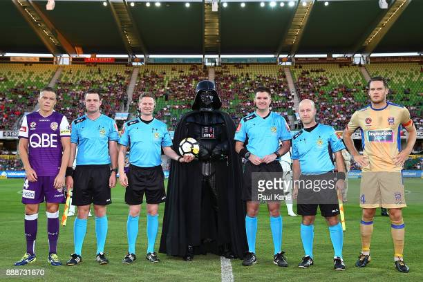 Darth Vader poses with referees together with Shane Lowry of the Glory and Nigel Boogaard of the Jets during the round 10 ALeague match between the...