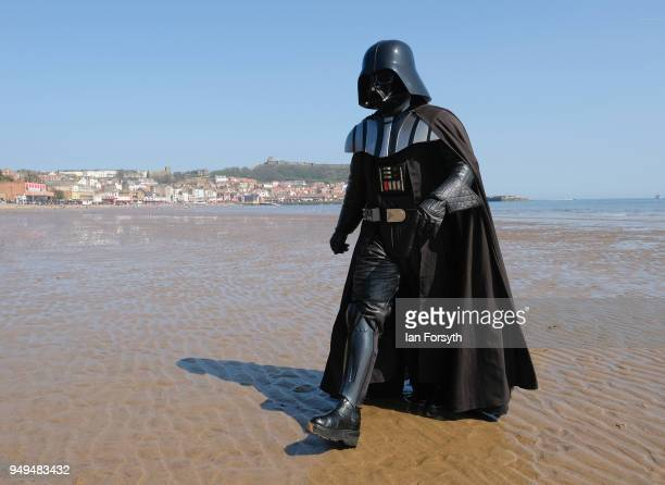 Darth Vader walks across the beach during the Scarborough SciFi event held at the seafront Spa Complex on April 21 2018 in Scarborough England The...