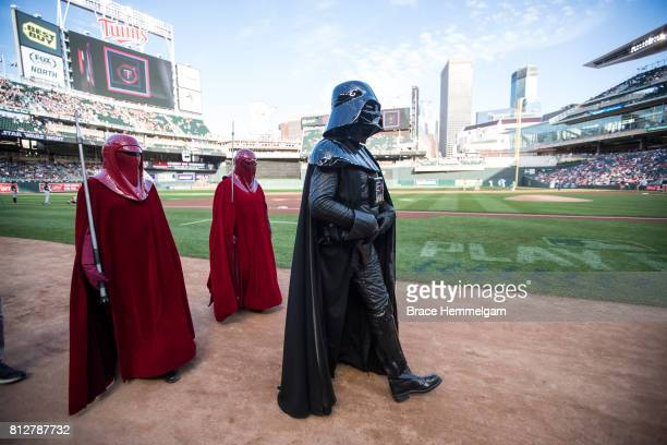 Darth Vader walks on the field prior to a Star Wars night game between the Minnesota Twins and Chicago White Sox on June 21 2017 at Target Field in...
