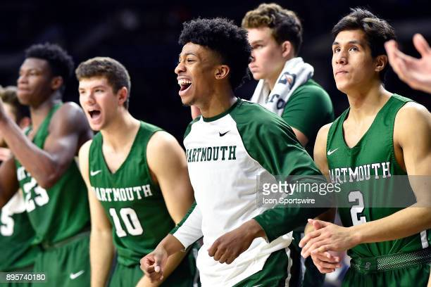 Dartmouth Big Green guard Cameron Smith and teammates celebrate from the bench during the game between the Notre Dame Fighting Irish and the...