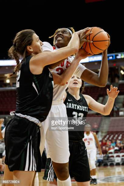Dartmouth Big Green guard/forward Paula Lenart and Ohio State Buckeyes forward Alexa Hart fight for control of the ball during a game between the...