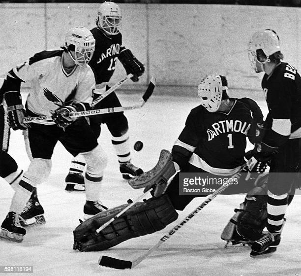 Dartmouth College goaltender Bob Gaudet right stops Boston College Paul Hammer's shot during a game at Conte Forum at BC in Chestnut Hill Mass on Jan...