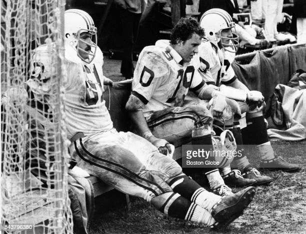 Dartmouth College offensive lineman Ed Snook Jeff Immelt and Andrew Ebbott wear pained expressions in the fourth quarter of a game against Harvard...