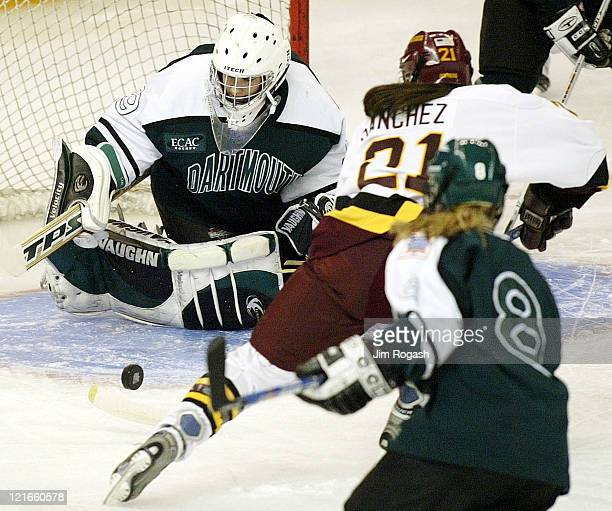 Dartmouth goalie Katherine Lane keeps Minnesota's Allie Sanchez from scoring as Dartmouth's Lesley Reiart looks on during the NCAA 2004 Women's...