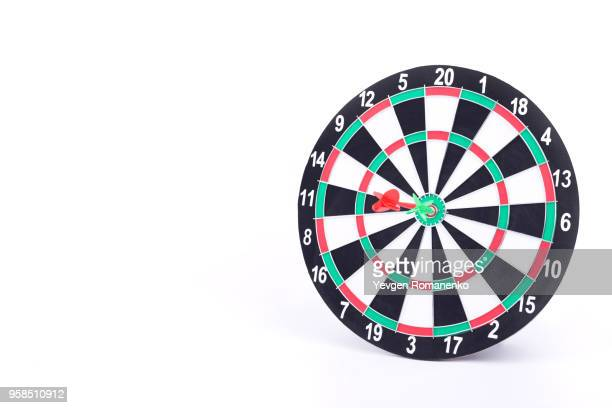 darts board isolated on white background. new dartboard for darts game. - dartboard stock pictures, royalty-free photos & images