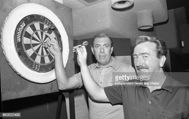Darts Exhibition match by International Player John Lowe in Molly Malone's giving Pady Cleary Castleknock Elms dart club advice circa October 1989