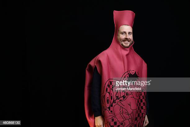 Darts fan Ashley Hatherell dressed as a whoopee cushion poses ahead Day Eight of the William Hill PDC World Darts Championships at Alexandra Palace...