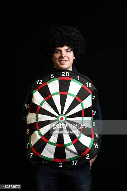 A darts fan dressed as a dart board poses ahead of Day Eight of the William Hill PDC World Darts Championships at Alexandra Palace on December 28...