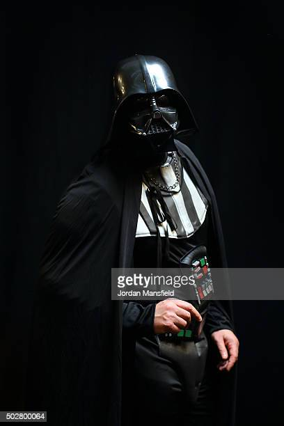 Darts fan Keiren Smith poses for a photo in fancy dress on Day Eleven of the 2016 William Hill PDC World Darts Championships at Alexandra Palace on...