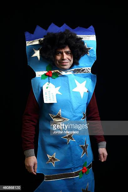 Darts fan Matthew Curtis dressed as a Christmas Cracker poses ahead Day Eight of the William Hill PDC World Darts Championships at Alexandra Palace...