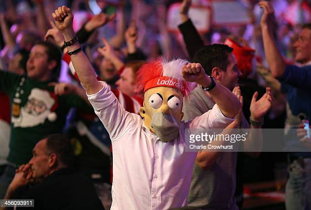 A darts fan wears a Homer Simpson mask during the Ladbrokescom World Darts Championship on Day One at Alexandra Palace on December 13 2013 in London...