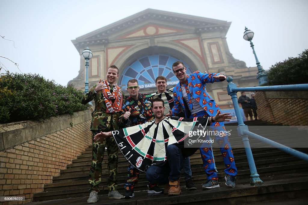 Darts fans arrive at Alexandra Palace in fancy dress ahead of the quarter finals of the 2016 William Hill World Darts Championship on December 30, 2016 in London, England. The event is the world's biggest darts tournament, with 72 players from across the globe competing across 15 days of the knock out competition.
