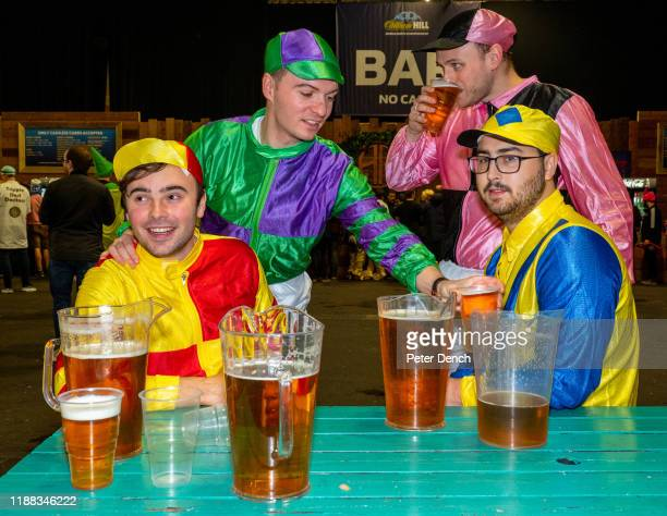 Darts fans dressed as jockeys in the Fans Village during the 2020 William Hill World Darts Championship at Alexandra Palace on December 13, 2019 in...