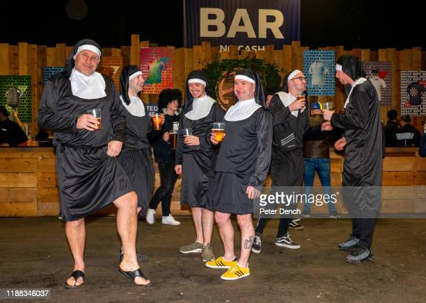 Darts fans dressed as nuns in the Fans Village during the 2020 William Hill World Darts Championship at Alexandra Palace on December 13, 2019 in...