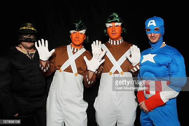 Darts fans dressed as Zoro OompaLoompas and Captain America pose prior to the Final of the 2011 Ladbrokescom World Darts Championship at Alexandra...