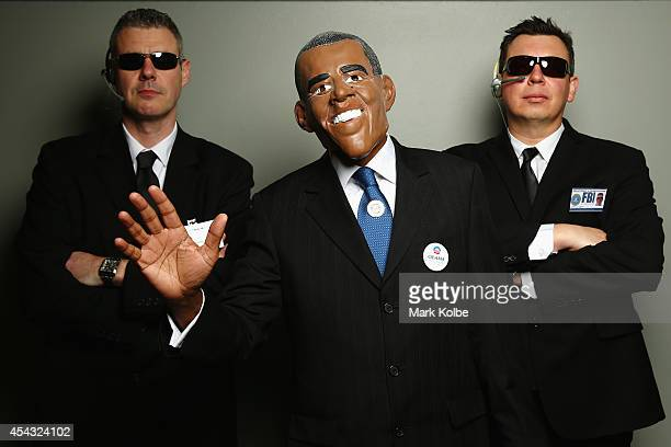 Darts fans in Barack Obama and security fancy dress pose as they arrive during the Sydney Darts Masters at Hordern Pavilion on August 29 2014 in...
