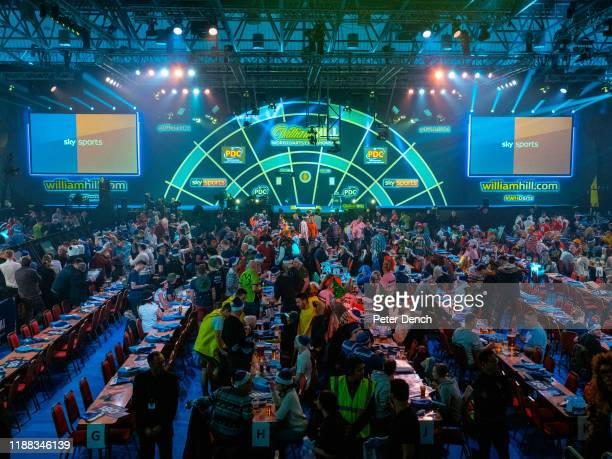 Darts fans in the main competition arena during the 2020 William Hill World Darts Championship at Alexandra Palace on December 13, 2019 in London,...
