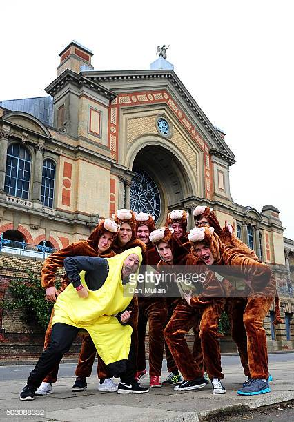 Darts fans pose outside the venue ahead of Day Thirteen of the 2016 William Hill PDC World Darts Championships at Alexandra Palace on January 1 2016...