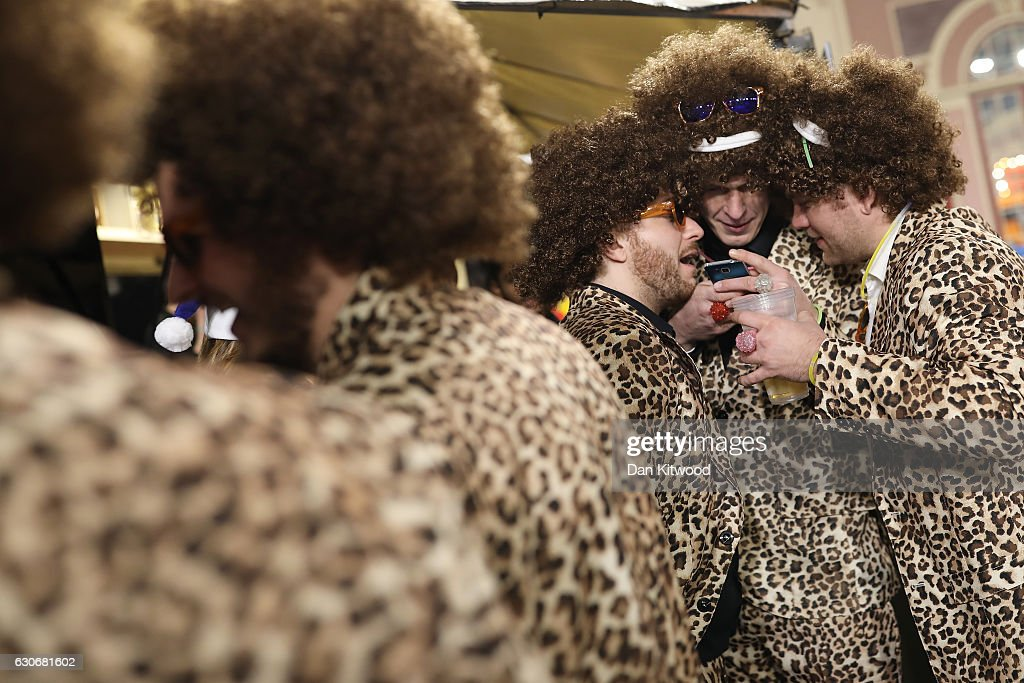 Darts fans take a break between quarter final matches the 2016 William Hill World Darts Championship on December 30, 2016 in London, England. The event is world's biggest darts tournament, with 72 players from across the globe competing across 15 days of the knock out competition.