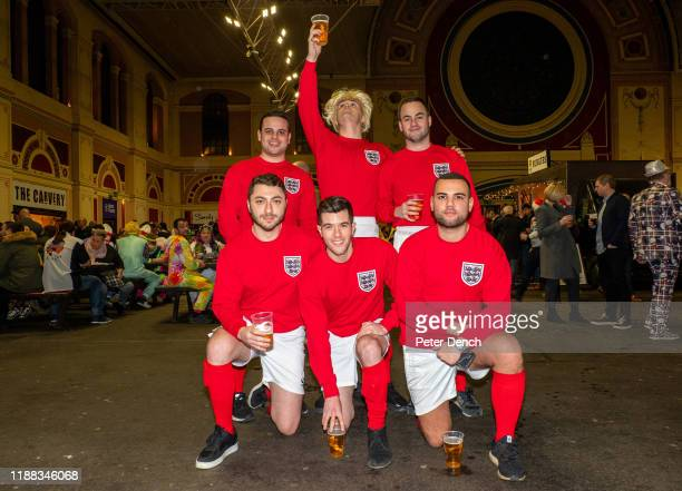 Darts fans wear 1966 England football kits in the Fans Village during the 2020 William Hill World Darts Championship at Alexandra Palace on December...